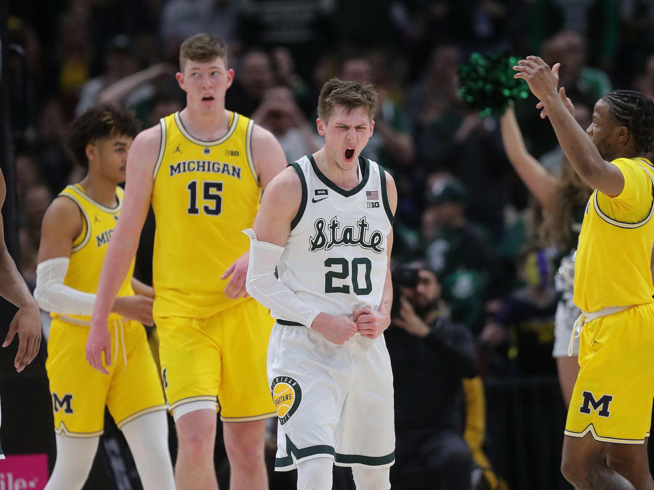 Michigan State guard Matt McQuaid celebrates after a basket against Michigan during second half of the Big Ten tournament championship Sunday, March 17, 2019 at the United Center in Chicago.