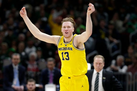 Michigan's Ignas Brazdeikis (13) reacts after shooting a 3-point basket during the first half of an NCAA college basketball championship game against Michigan State in the Big Ten Conference tournament, Sunday, March 17, 2019, in Chicago. (AP Photo/Kiichiro Sato)