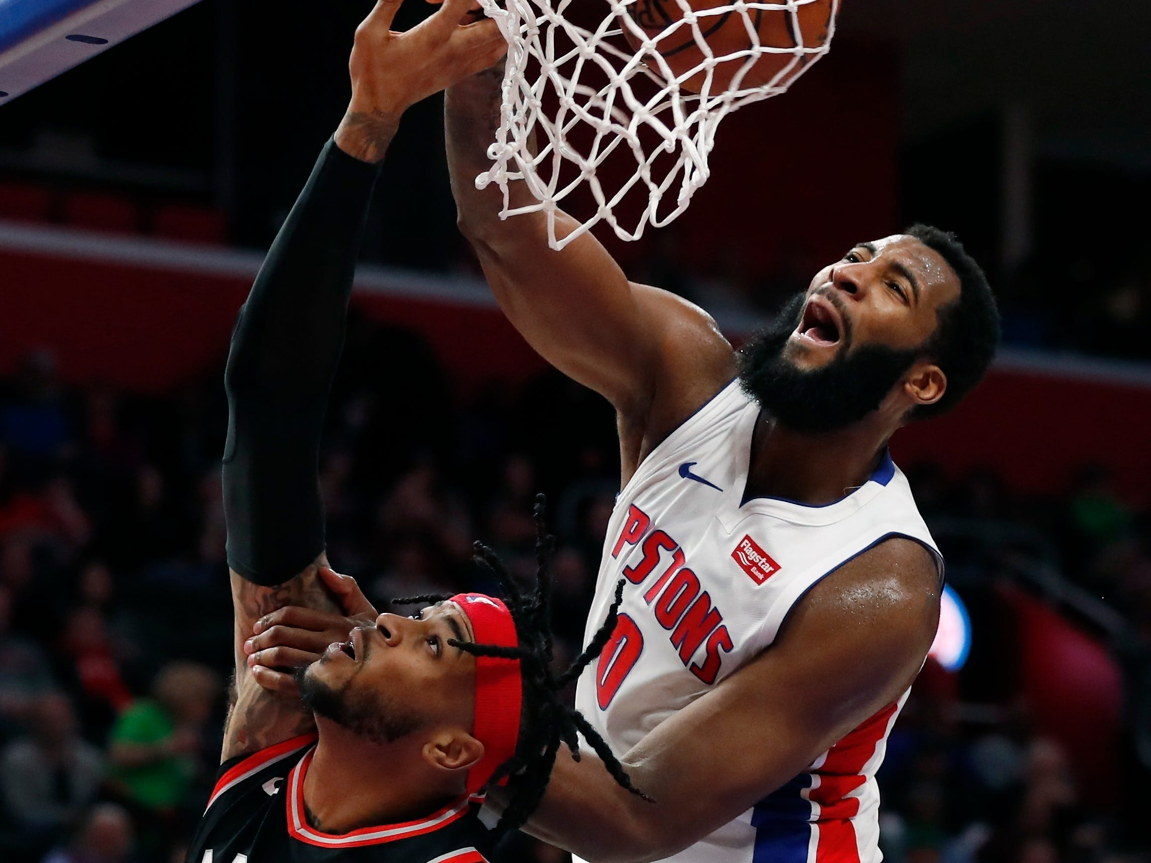 Andre Drummond dunks on Toronto Raptors' Eric Moreland during the second half of the Detroit Pistons' 110-107 win Sunday, March 17, 2019, in Detroit.