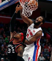 Andre Drummond dunks on Raptors' Eric Moreland during the second half Sunday at LCA.