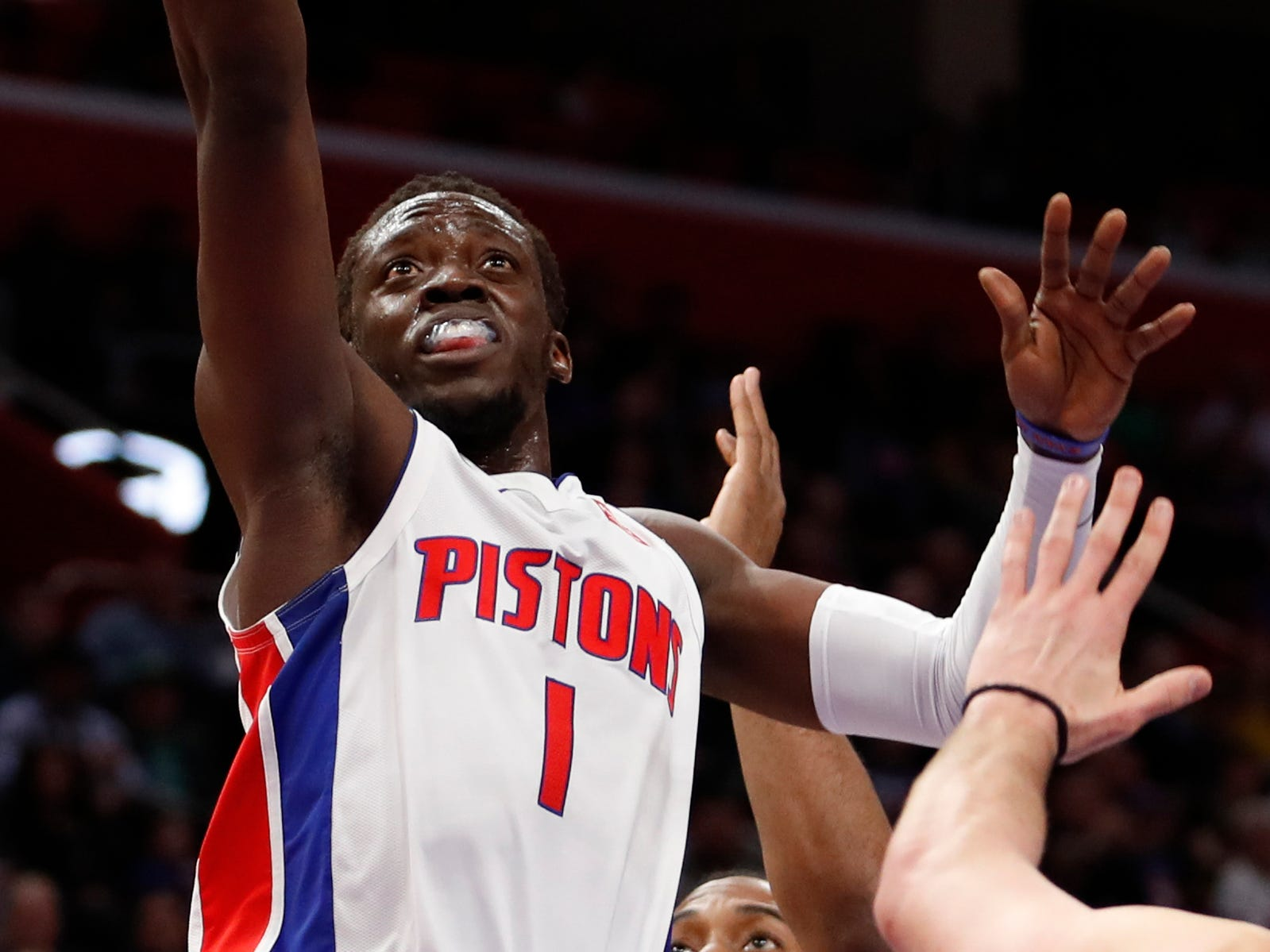 Detroit Pistons guard Reggie Jackson shoots against the Toronto Raptors in the first quarter at Little Caesars Arena, March 17, 2019, in Detroit.