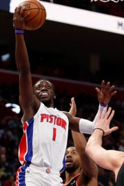 Reggie Jackson shoots against the Raptors in the first quarter at Little Caesars Arena on Sunday.