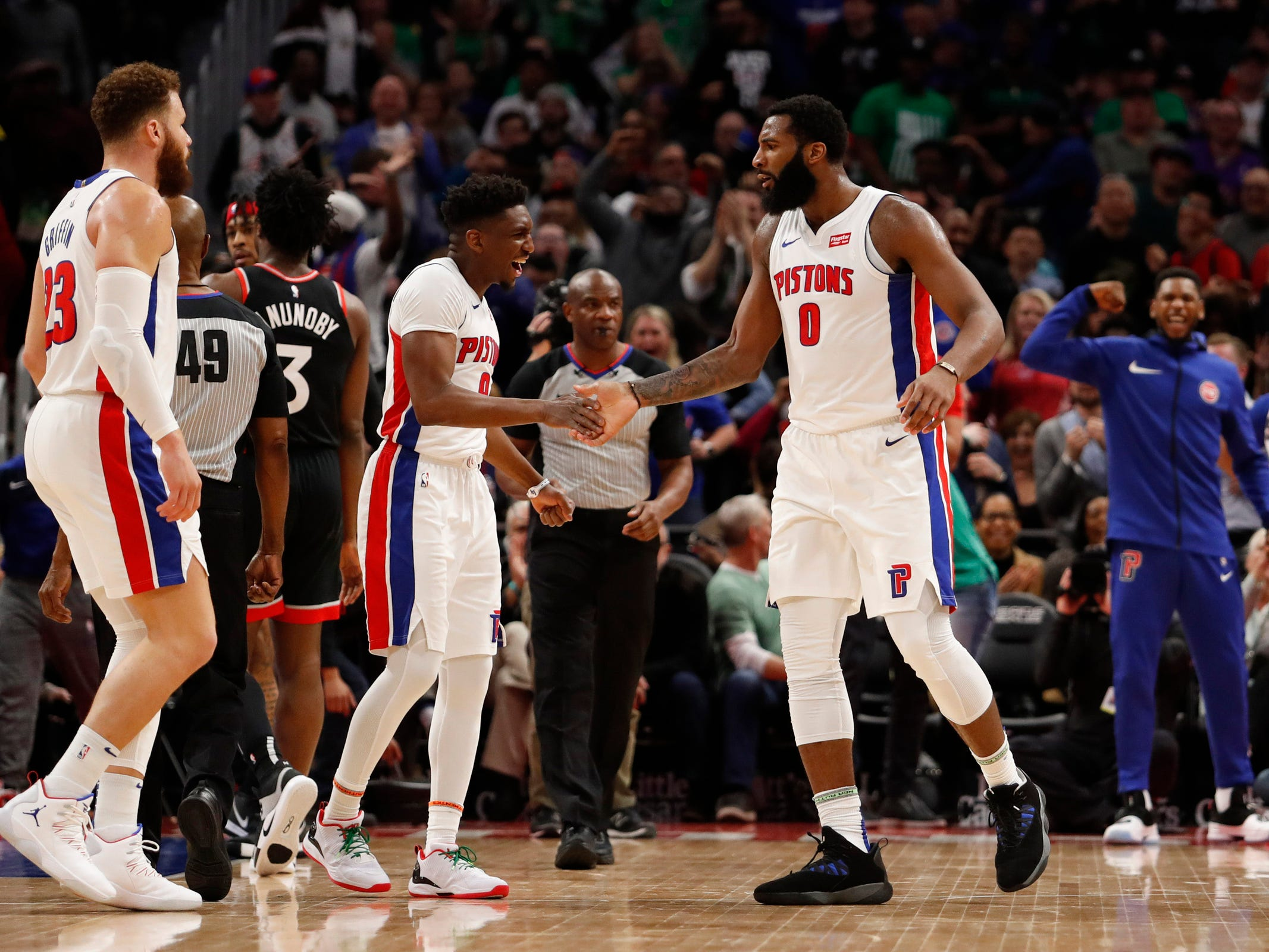 Detroit Pistons center Andre Drummond (0) celebrates with Langston Galloway during the third quarter against the Toronto Raptors at Little Caesars Arena, Sunday, March 17, 2019.