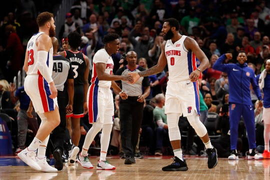 Andre Drummond celebrates with Langston Galloway during the third quarter against Toronto.
