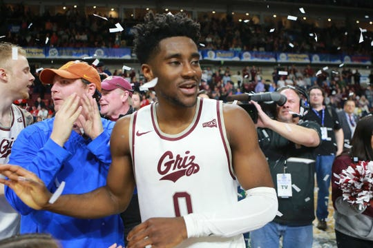 Mar 16, 2019; Boise, ID, USA; Montana Grizzlies guard Michael Oguine (0) celebrate the win over the Eastern Washington Eagles at the Big Sky Conference Mens Championship game at CenturyLink Arena. Montana defeats Eastern Washington 68-62.