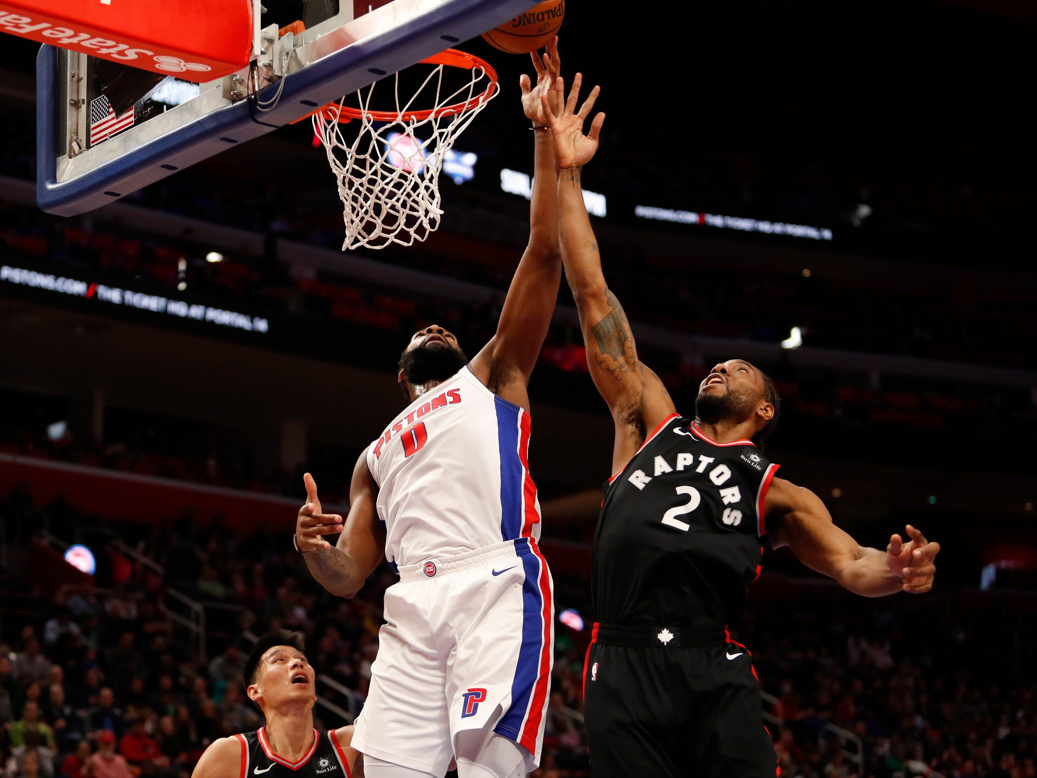 Detroit Pistons center Andre Drummond tips the ball in against Toronto Raptors forward Kawhi Leonard during the first quarter at Little Caesars Arena, March 17, 2019, in Detroit.
