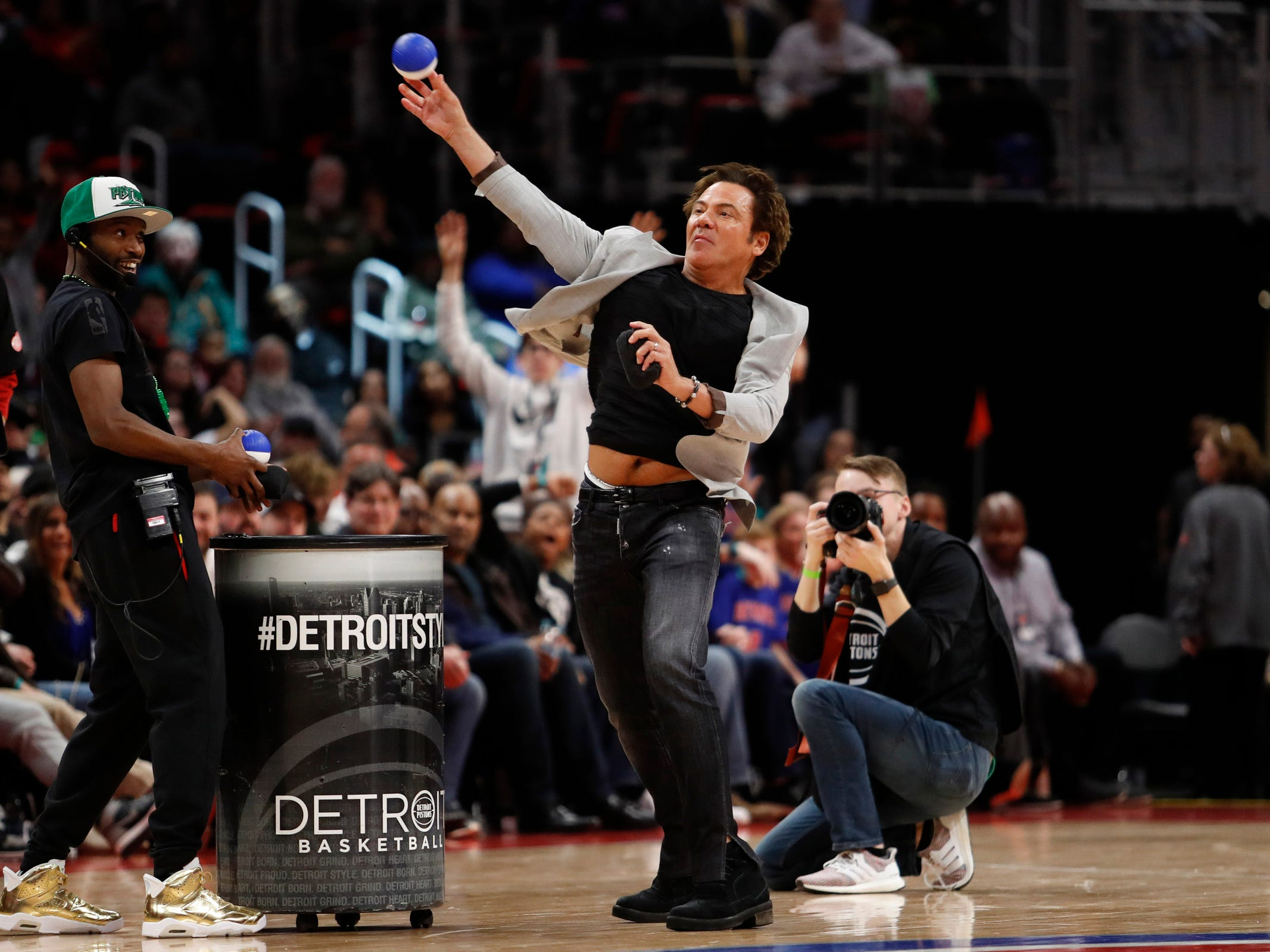 Detroit Pistons owner Tom Gores throws a ball into the crowd during the fourth quarter of the 110-107 win over the Toronto Raptors at Little Caesars Arena, Sunday, March 17, 2019.