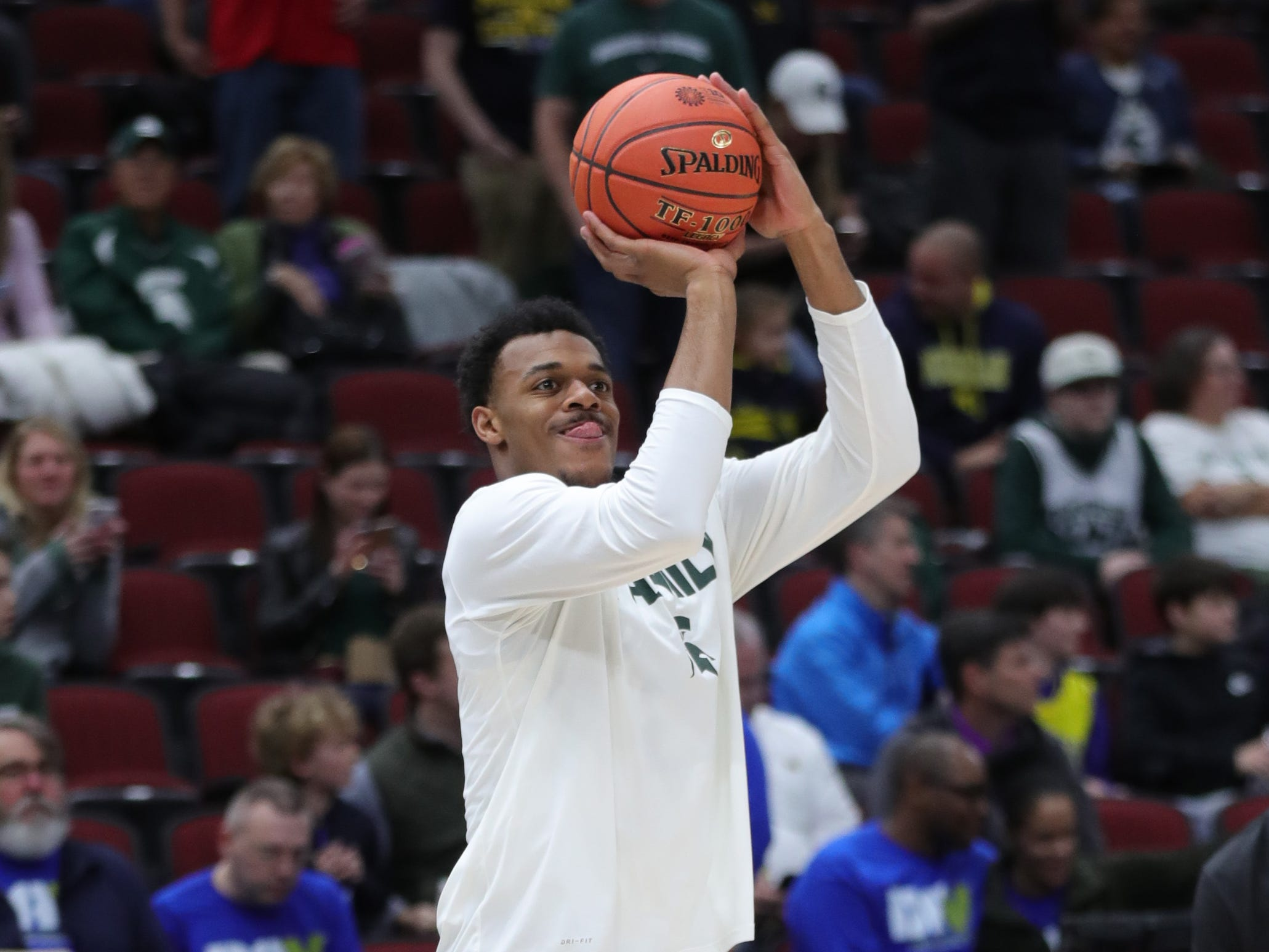 Michigan State's Xavier Tillman warms up before the Big Ten tournament championship against Michigan, Sunday, March 17, 2019 at the United Center in Chicago.