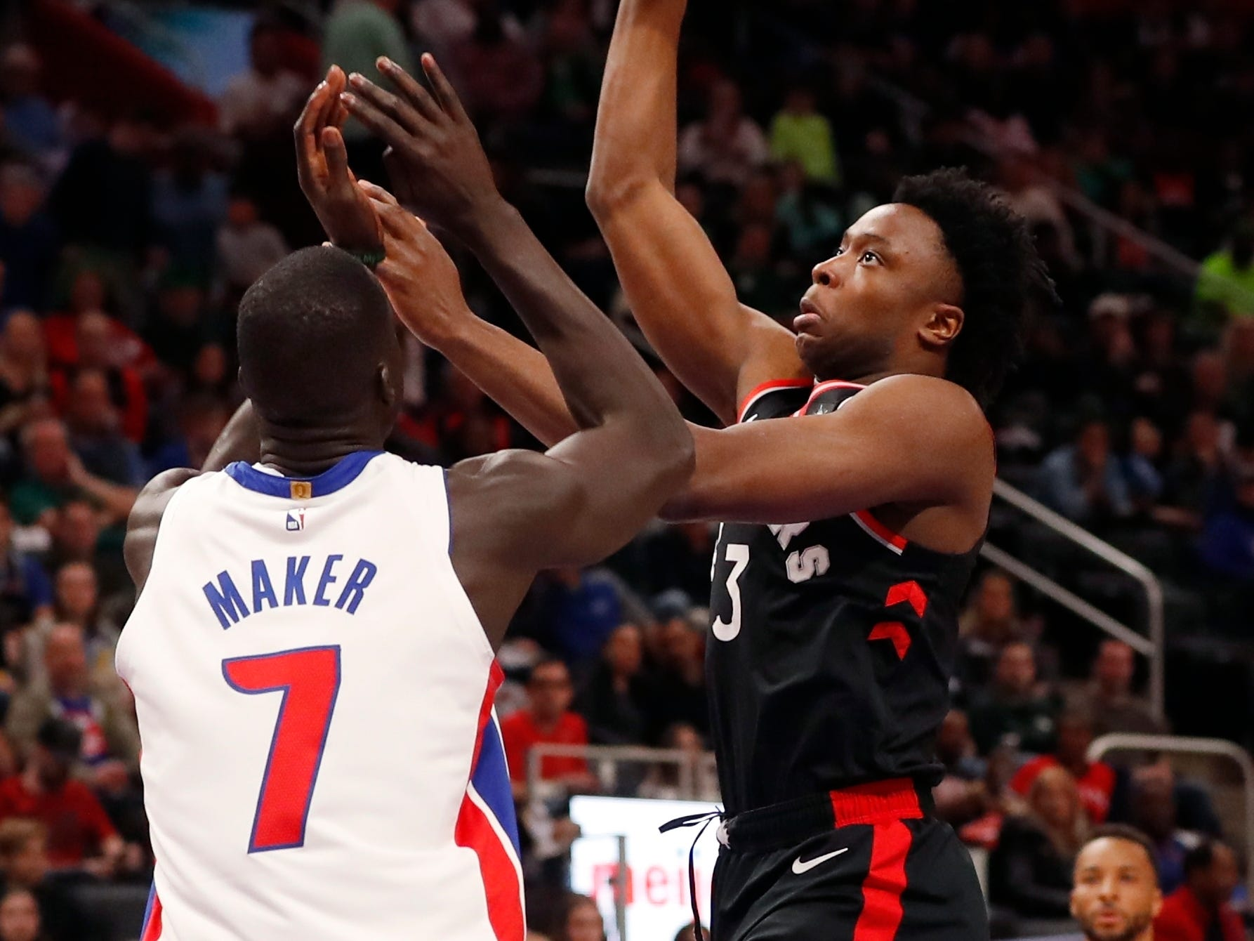 Toronto Raptors forward OG Anunoby shoots over the defense of Detroit Pistons forward Thon Maker during the first half Sunday, March 17, 2019, in Detroit.