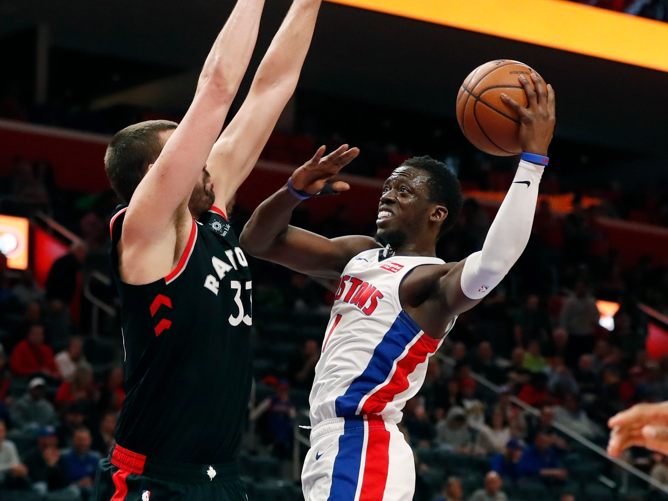 Reggie Jackson attempts a layup over Toronto Raptors center Marc Gasol during the second half of the Detroit Pistons' 110-107 win Sunday, March 17, 2019, in Detroit.