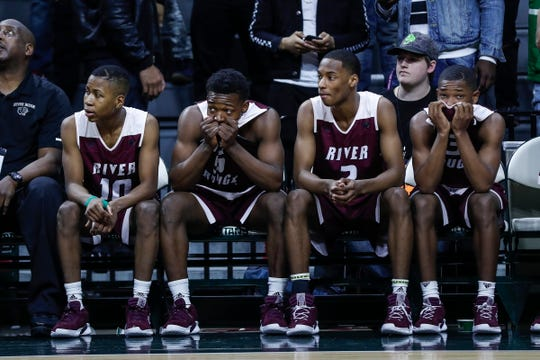 The River Rouge bench watches the final seconds of the MHSAA Division 2 final against Hudsonville Unity Christian, March 16, 2019.