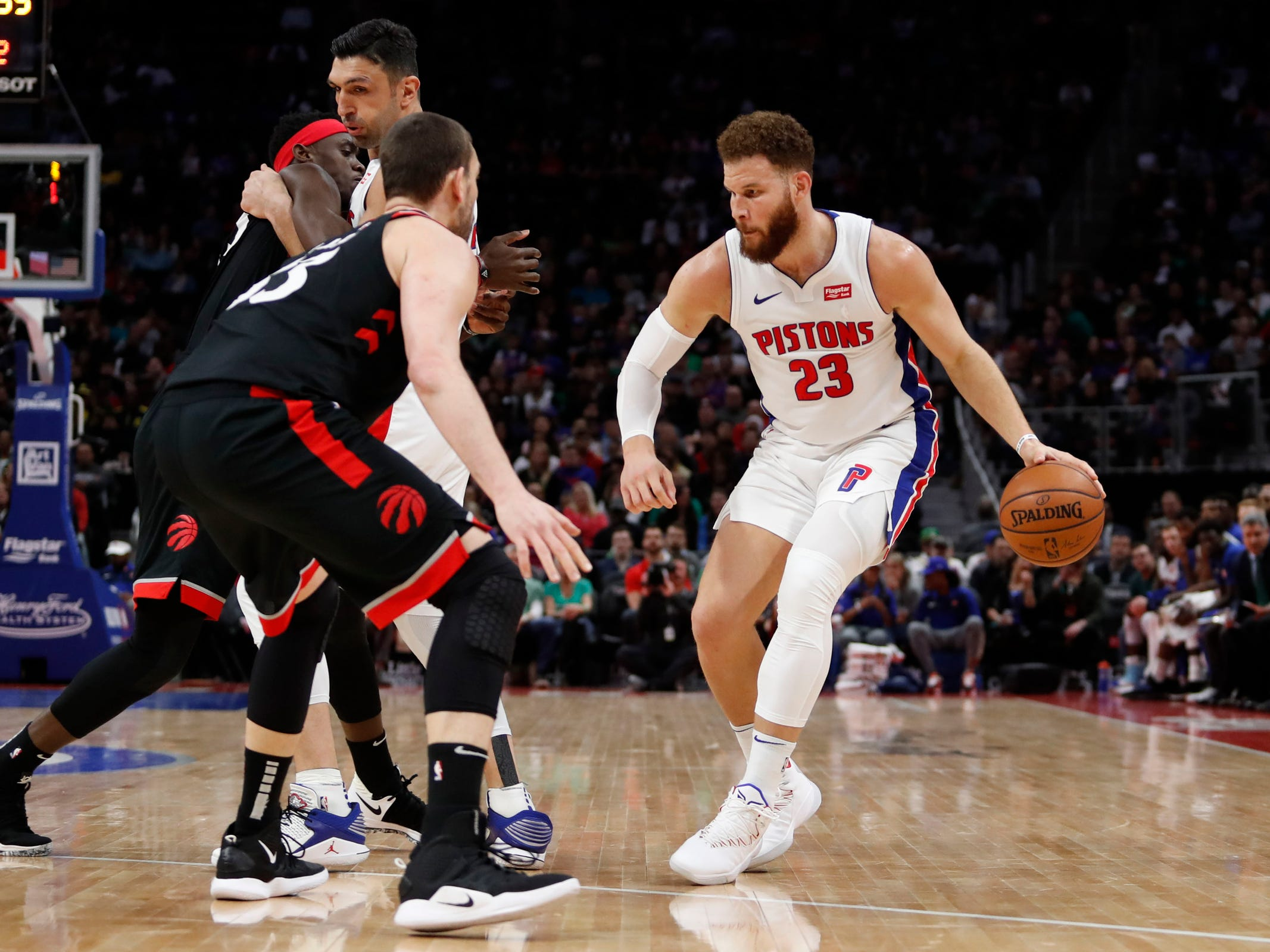 Detroit Pistons forward Blake Griffin dribbles against Toronto Raptors center Marc Gasol during the first quarter at Little Caesars Arena, Sunday, March 17, 2019.
