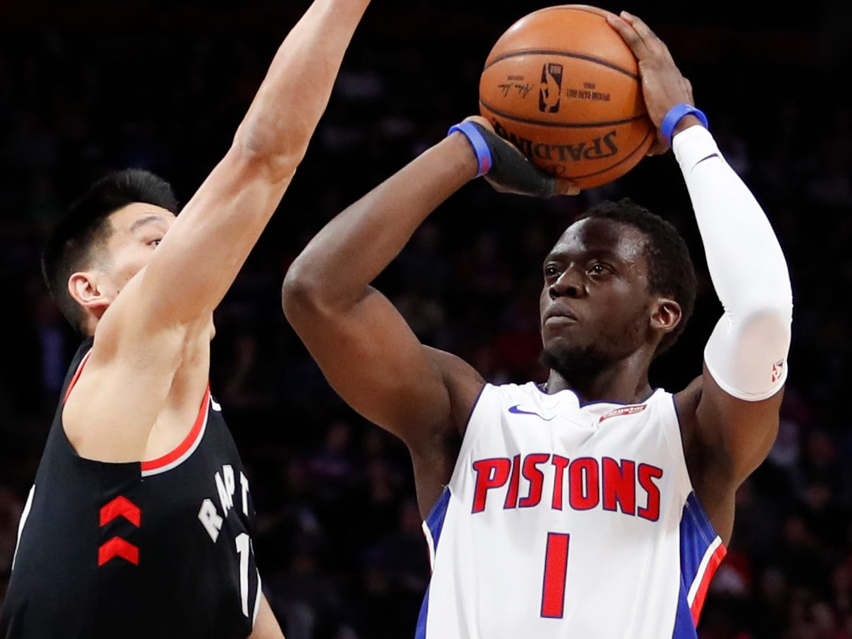 Detroit Pistons guard Reggie Jackson is defended by Toronto Raptors guard Jeremy Lin during the first quarter at Little Caesars Arena, March 17, 2019, in Detroit.