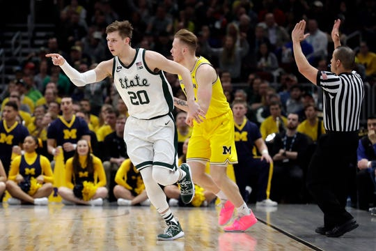 Michigan State's Matt McQuaid reacts after scoring a 3-pointer during the first half against Michigan in the Big Ten tournament championship Sunday, March 17, 2019, in Chicago.