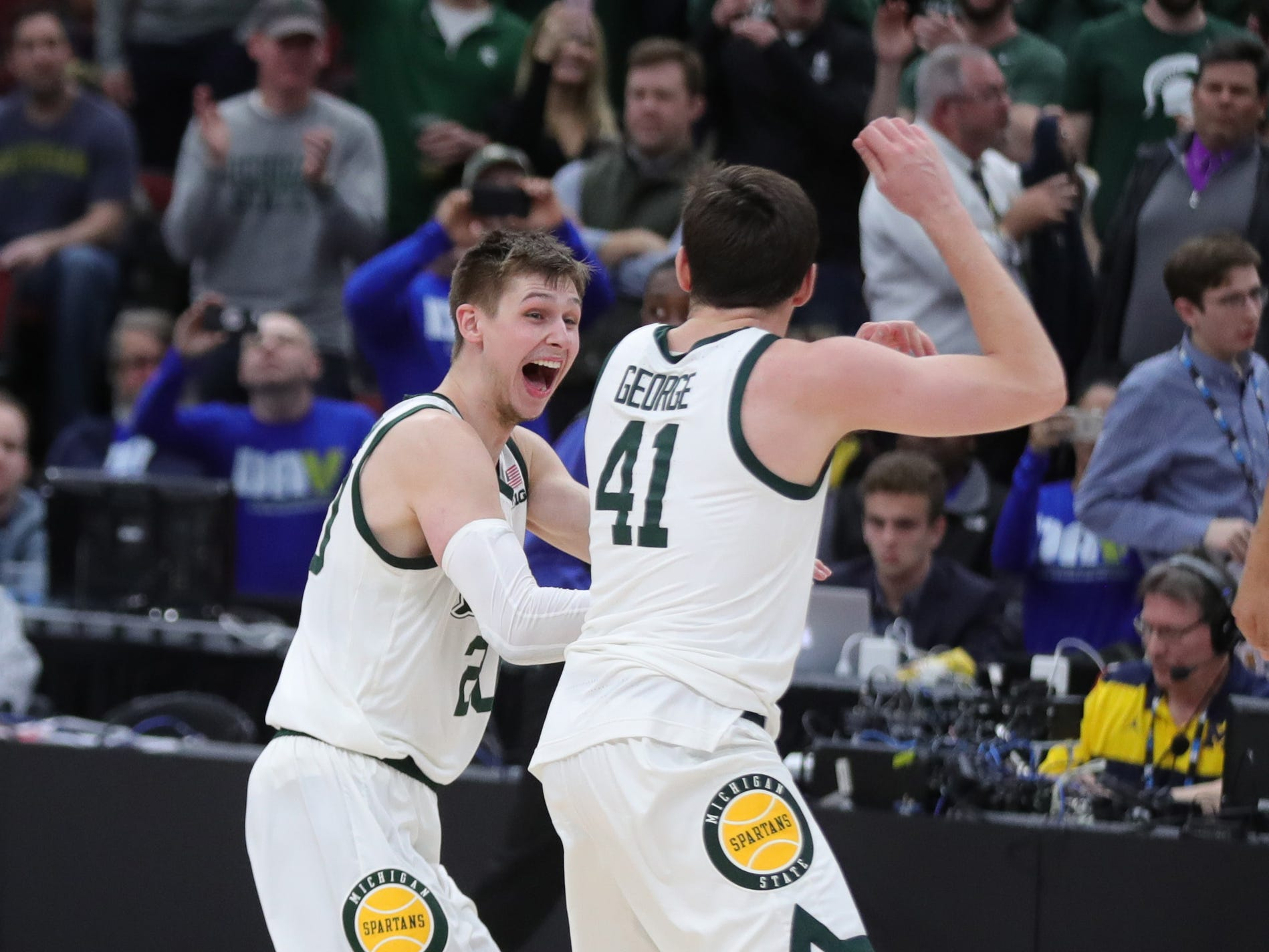 Michigan State's Matt McQuaid, left, and Connor George celebrate the 65-60 win against Michigan in the Big Ten tournament championship Sunday, March 17, 2019 at the United Center in Chicago.