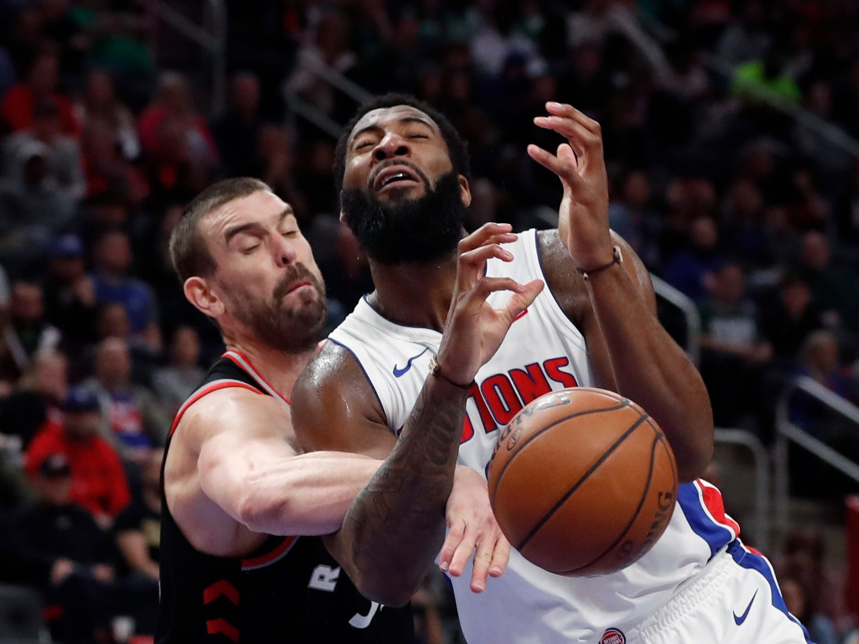 Toronto Raptors center Marc Gasol strips the ball from Andre Drummond during the second half of the Detroit Pistons' 110-107 win Sunday, March 17, 2019, in Detroit.