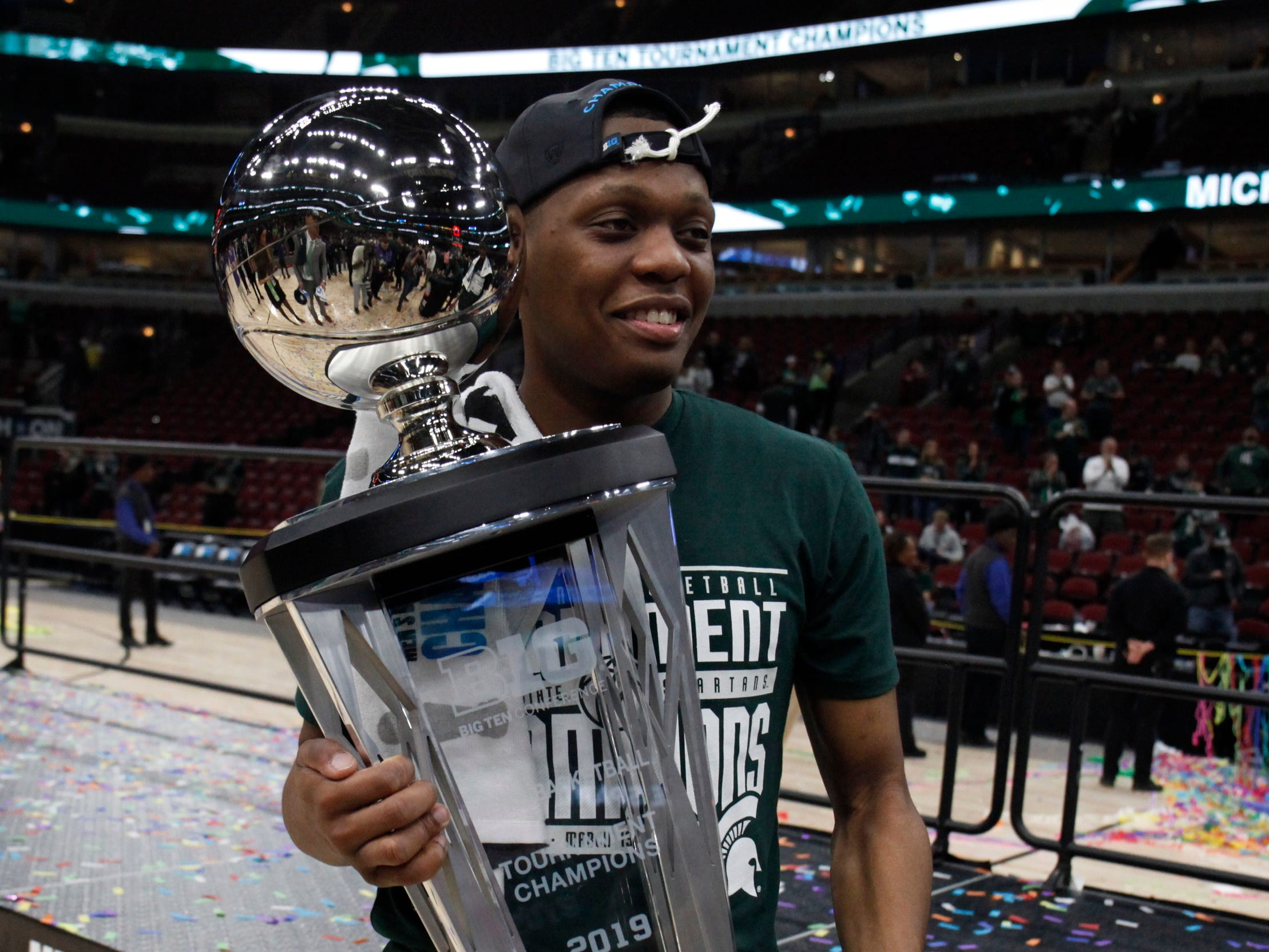 Michigan State guard Cassius Winston with the Big Ten tournament championship trophy after defeating Michigan, 65-60, Sunday, March 17, 2019 at the United Center in Chicago.