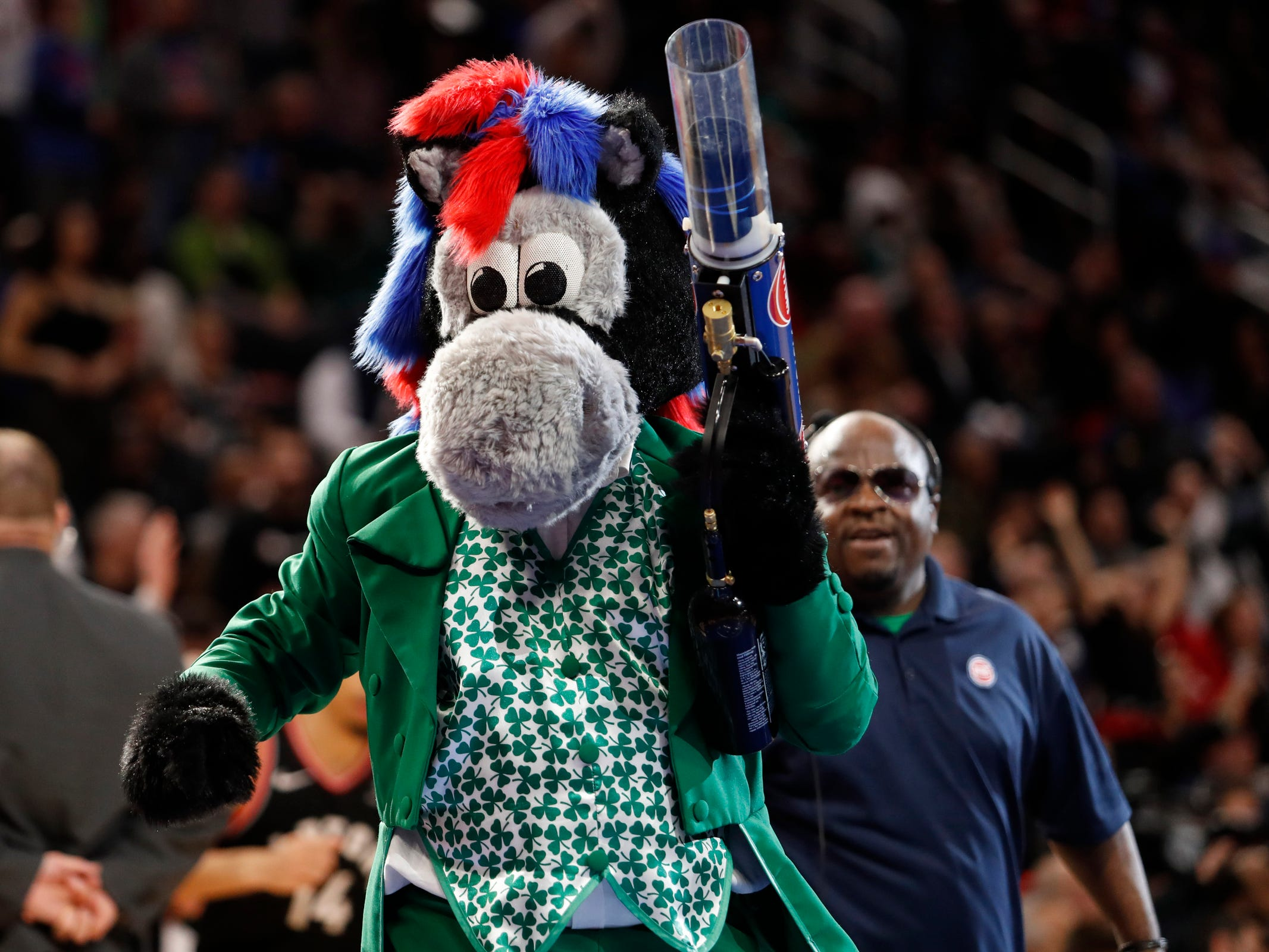 Detroit Pistons mascot Hooper looks to shoot a T-shirt into the crowd during the fourth quarter against the Toronto Raptors at Little Caesars Arena, Sunday, March 17, 2019.