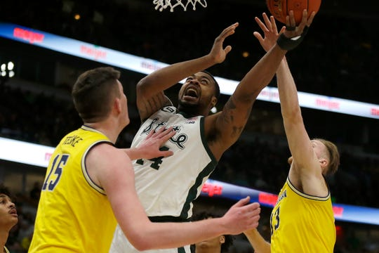 Michigan State's Nick Ward goes up for a shot against Michigan during the first half in the Big Ten tournament Sunday, March 17, 2019, in Chicago.