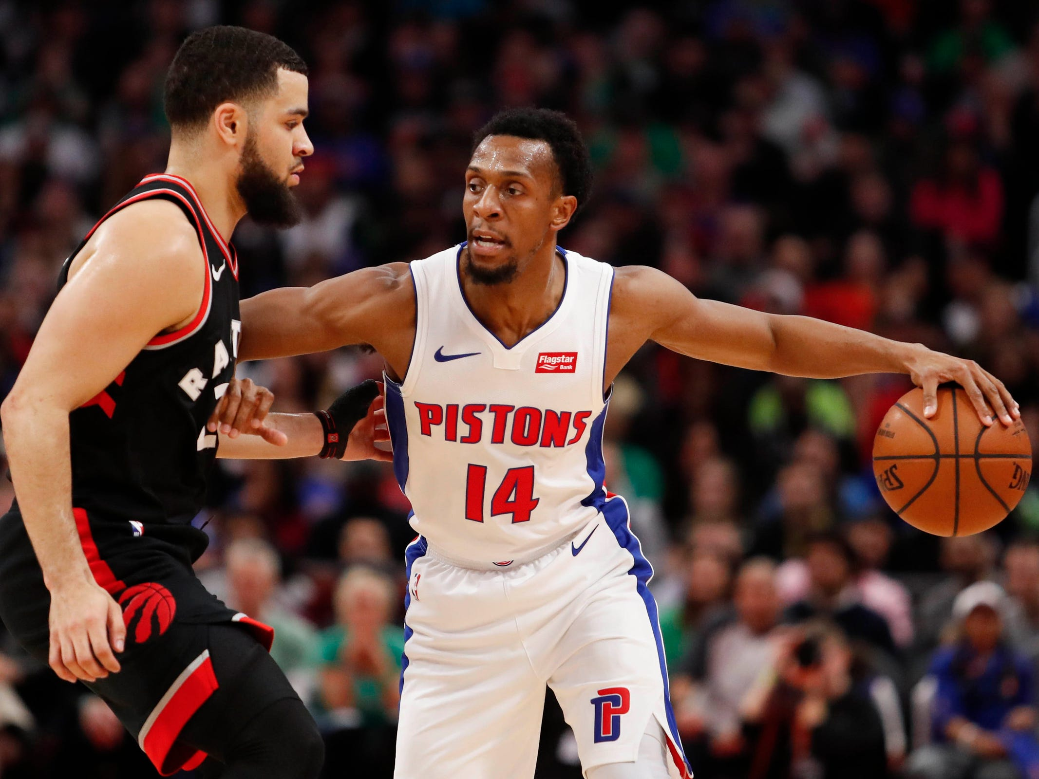 Detroit Pistons guard Ish Smith is defended by Toronto Raptors guard Fred VanVleet during the second quarter at Little Caesars Arena, Sunday, March 17, 2019.