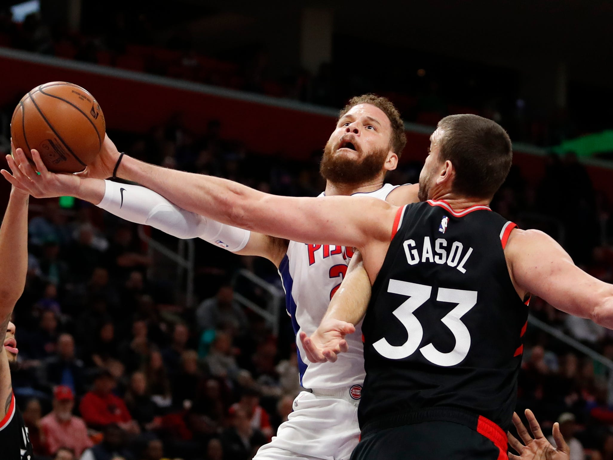 Detroit Pistons forward Blake Griffin goes up for a shot against Toronto Raptors center Marc Gasol and guard Danny Green during the first quarter at Little Caesars Arena, March 17, 2019, in Detroit.