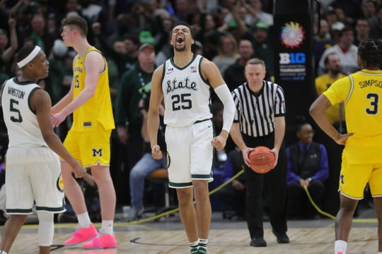 Michigan State's Kenny Goins celebrates the 65-60 win against Michigan in the Big Ten tournament championship Sunday, March 17, 2019 at the United Center in Chicago.