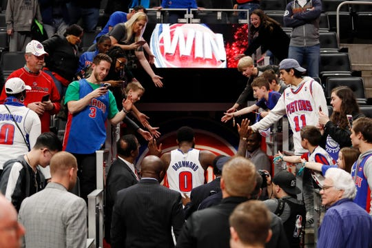 Detroit Pistons center Andre Drummond (0) celebrates with fans as he walks to the locker room after the 110-107 win against the Toronto Raptors at Little Caesars Arena, Sunday, March 17, 2019.
