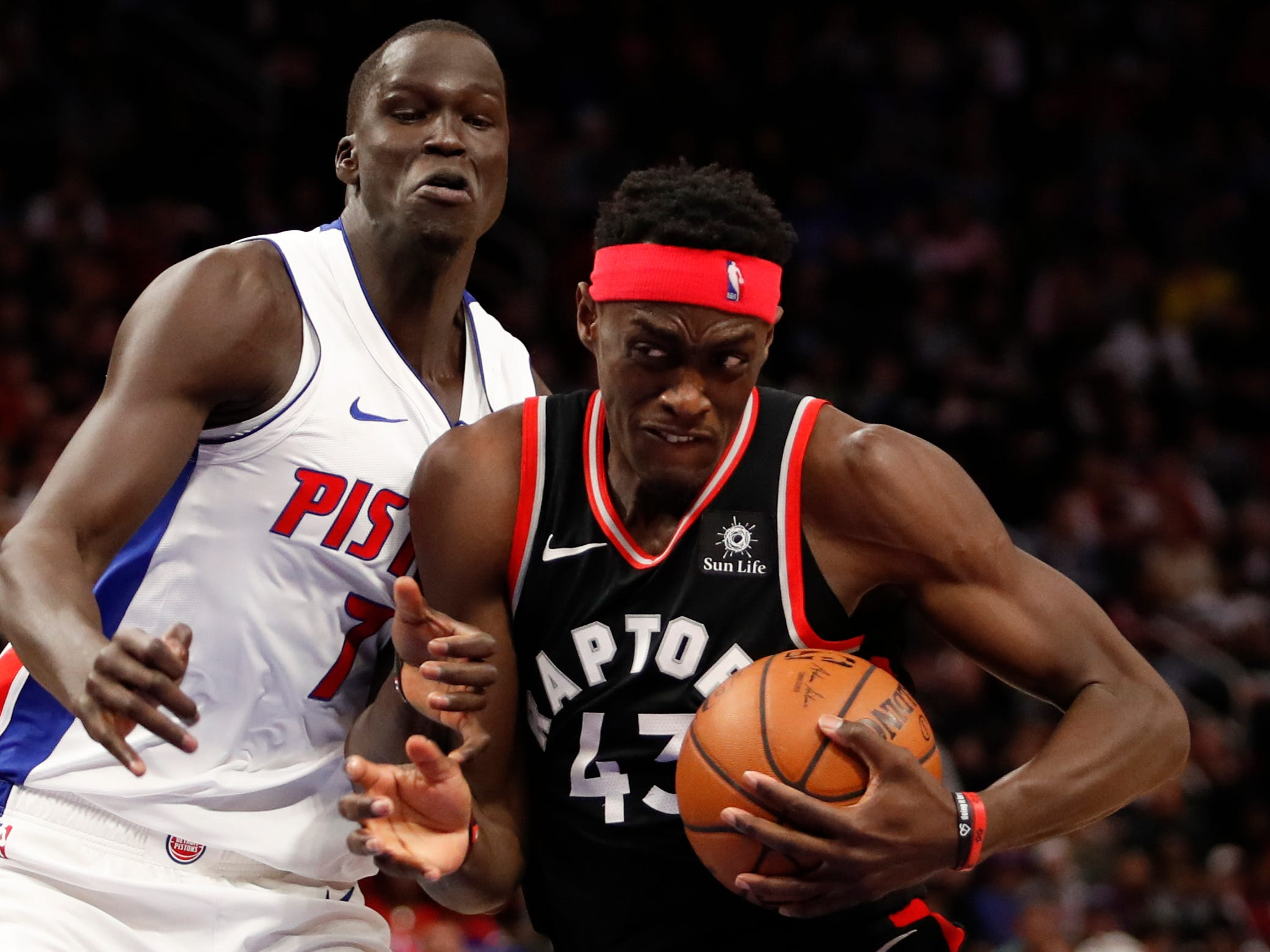 Toronto Raptors forward Pascal Siakam drives to the basket against Thon Maker during the third quarter of the Detroit Pistons' 110-107 win at Little Caesars Arena, Sunday, March 17, 2019.