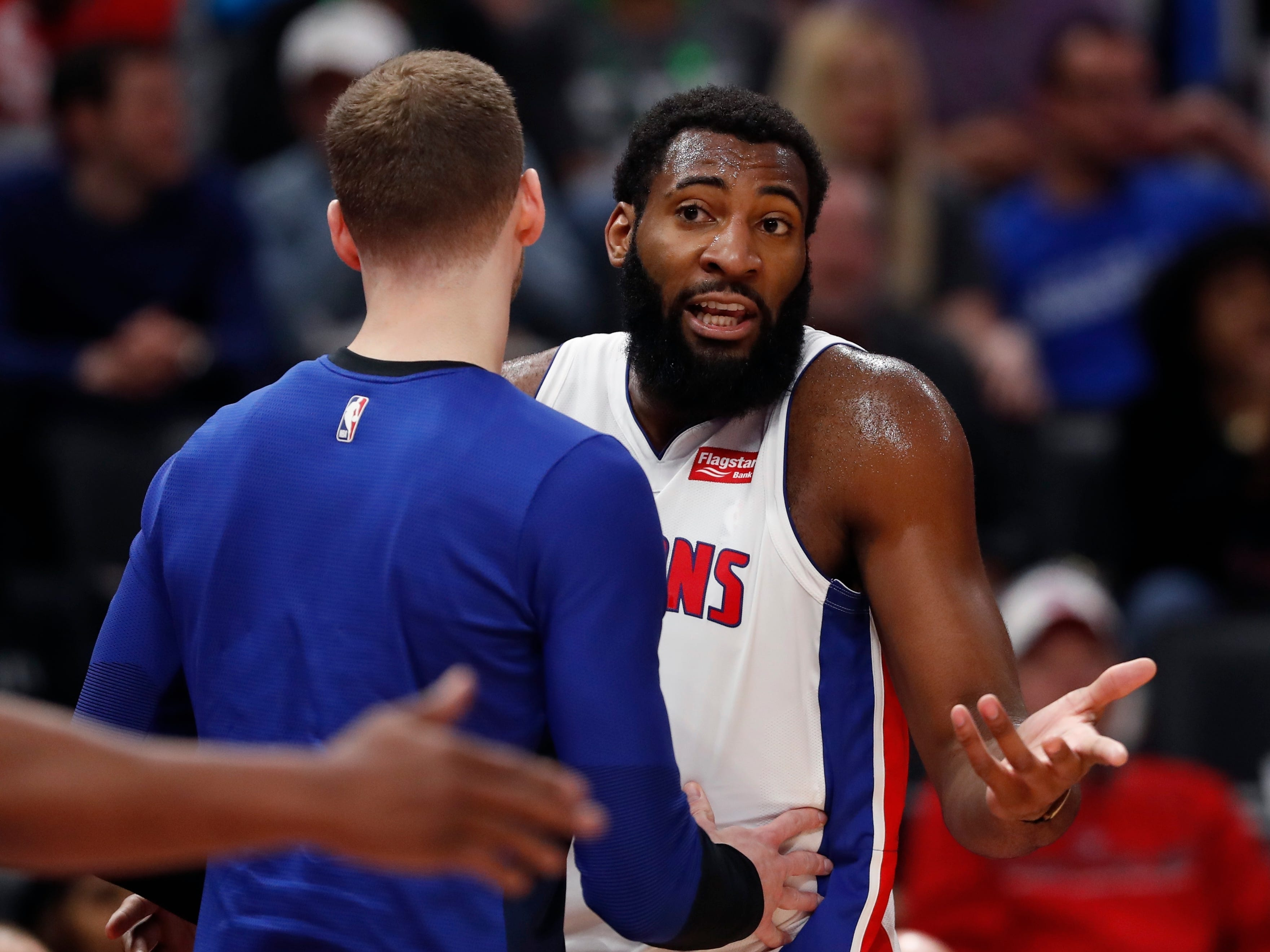 Detroit Pistons center Andre Drummond, right, looks toward the referee after a call during the first half against the Toronto Raptors, Sunday, March 17, 2019, in Detroit.