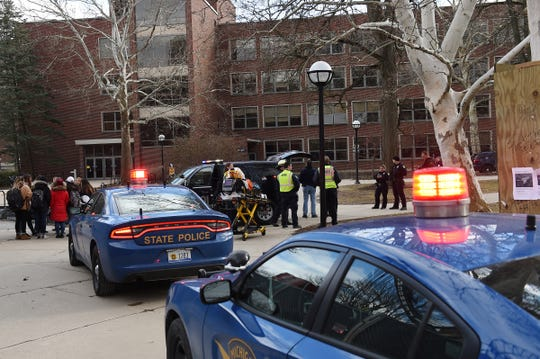Law enforcement from multiple agencies respond to an alleged active shooter situation at the University of Michigan near the Diag in Ann Arbor on Sat., March 16, 2019.