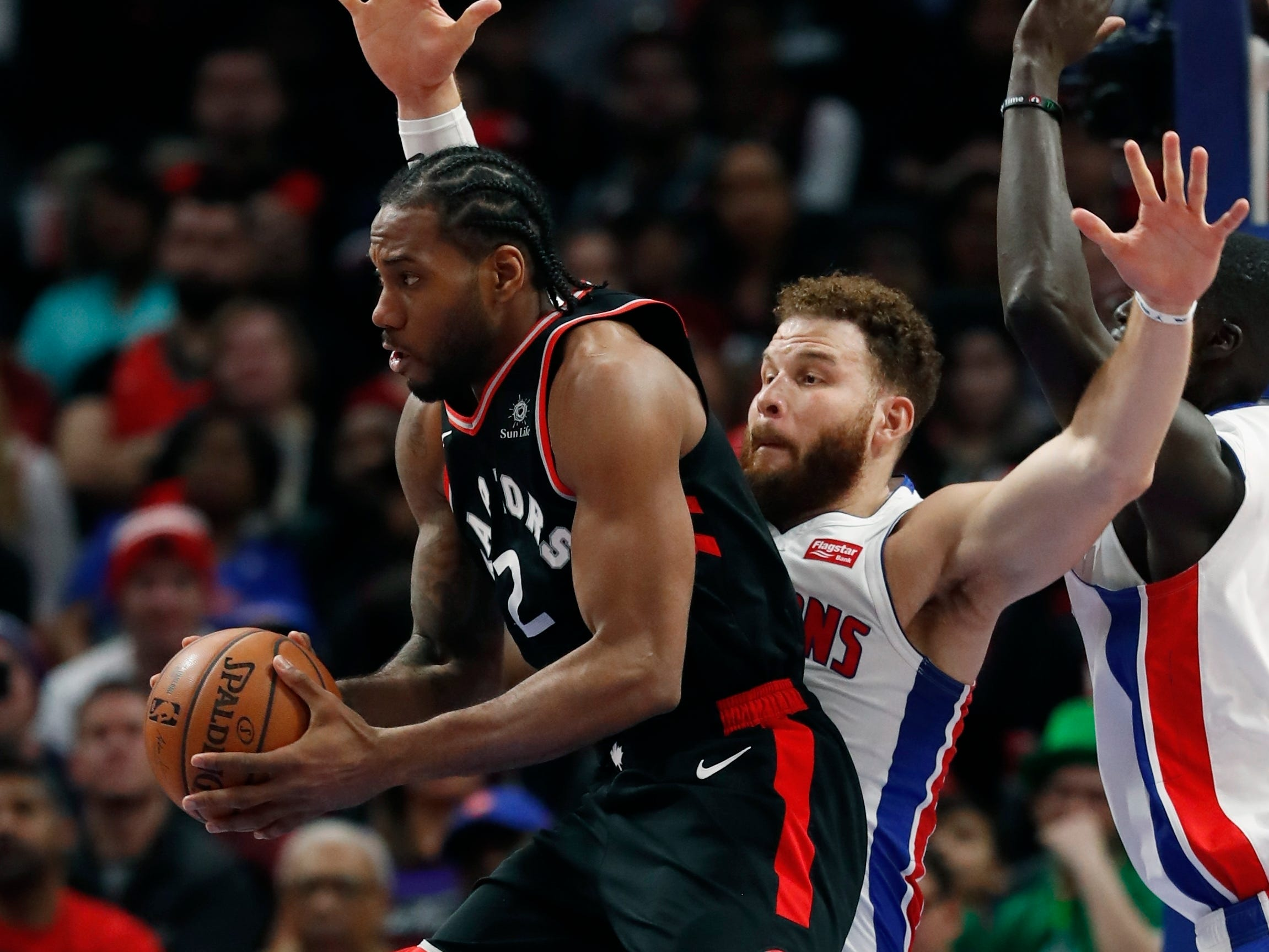 Toronto Raptors forward Kawhi Leonard passes as Blake Griffin defends during the second half of the Detroit Pistons' 110-107 win Sunday, March 17, 2019, in Detroit.