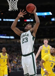 Xavier Tillman scores against Michigan on Sunday in Chicago.
