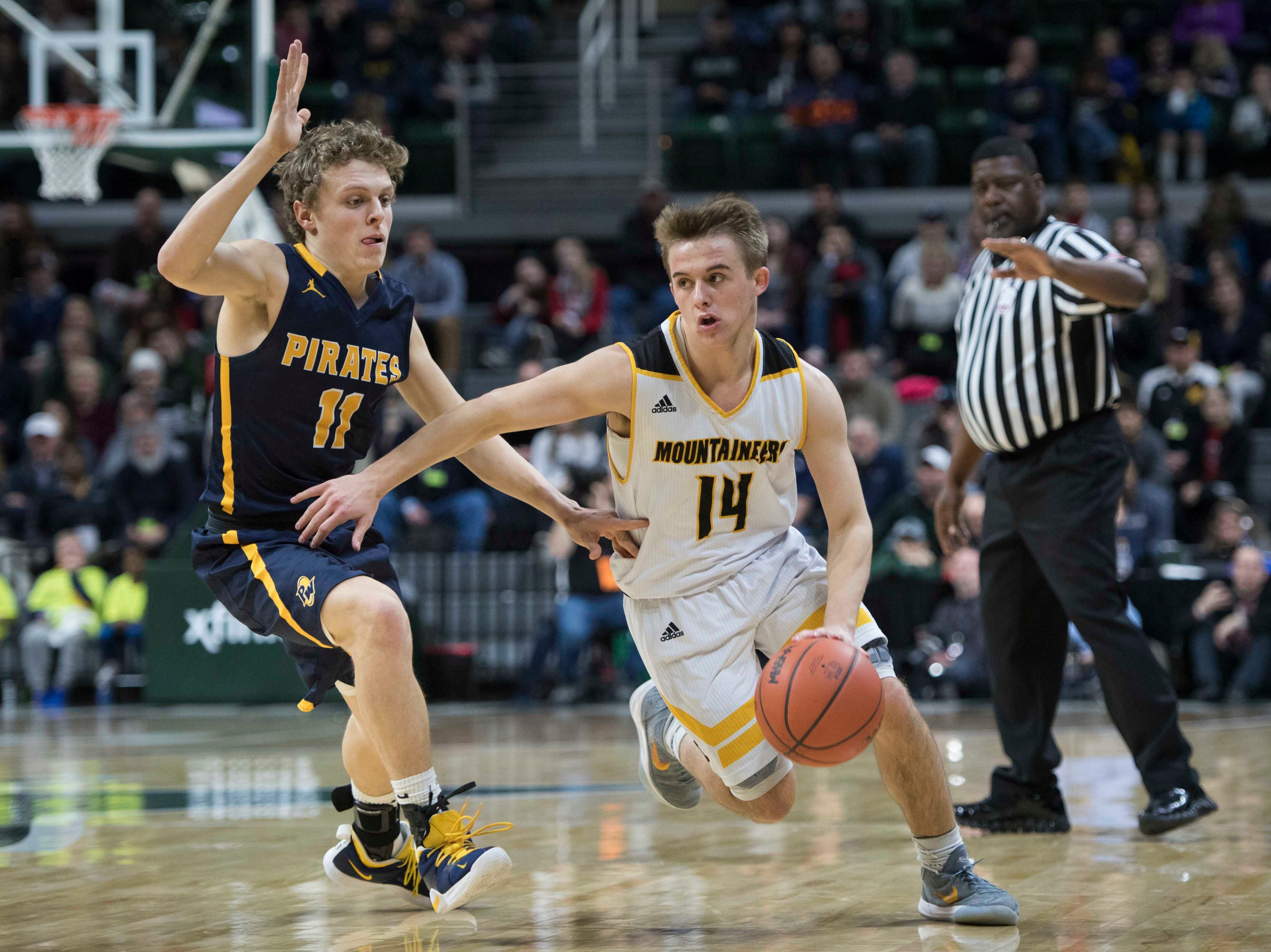 Pewamo-Westphalia's Collin Trierweiler covers Iron Mountain's Marcus Johnson in the second half.