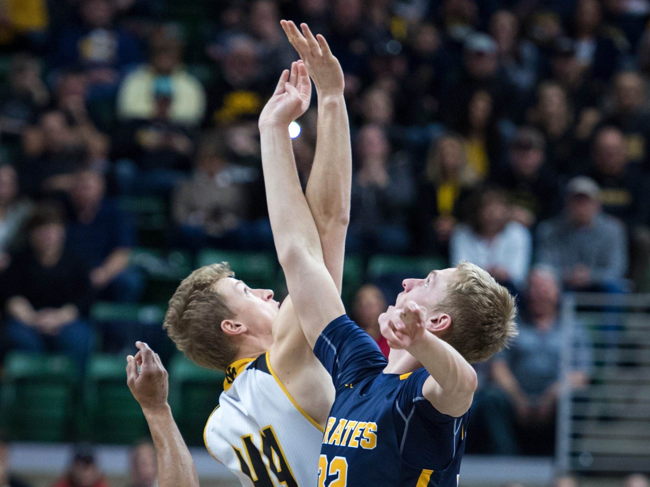 Iron Mountain's Charlie Gerhard and Pewamo-Westphalia's Andre Smith jump for the tipoff in the first half.