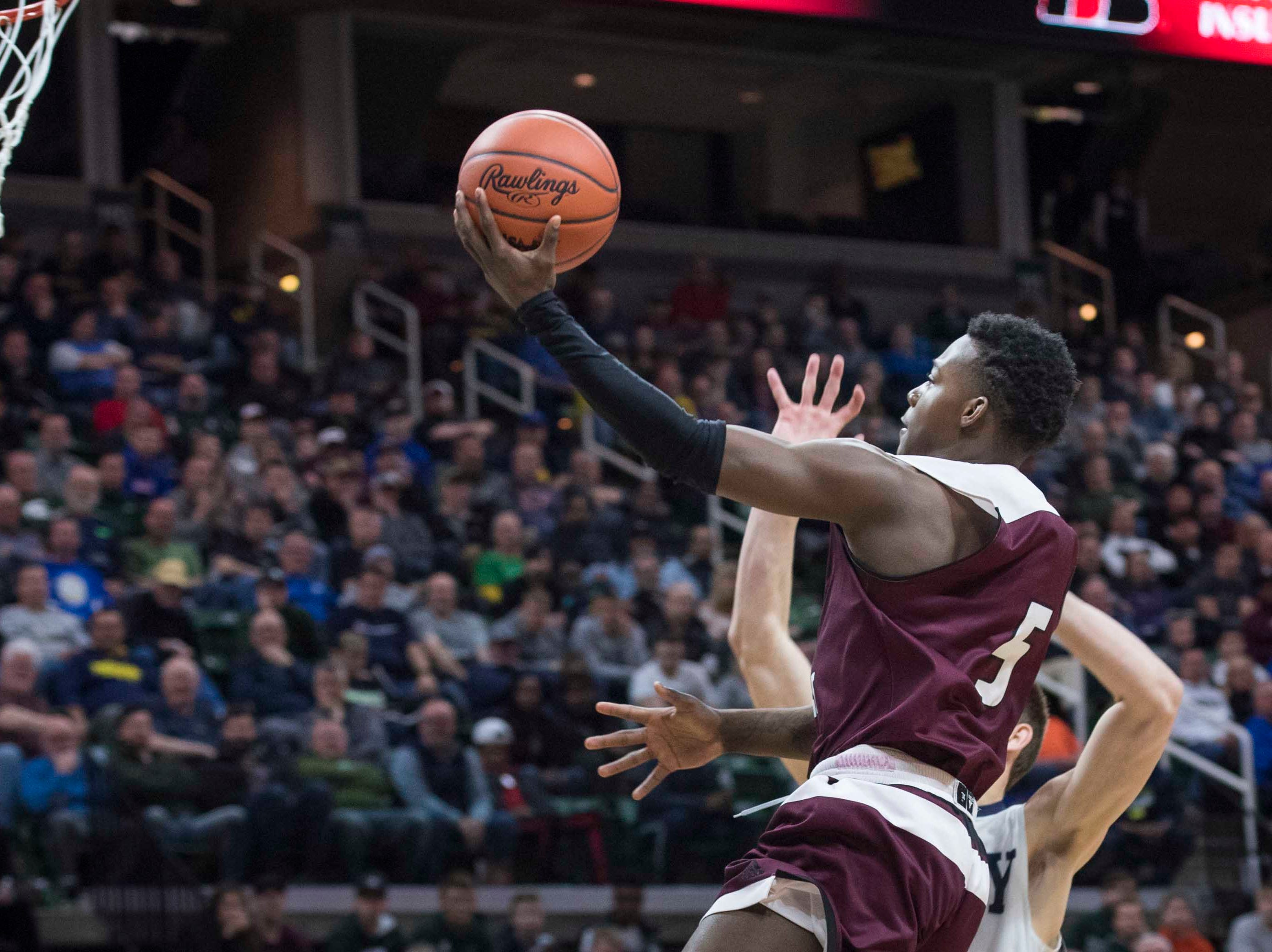River Rouge's Jason Norton shoots a layup in the first half.