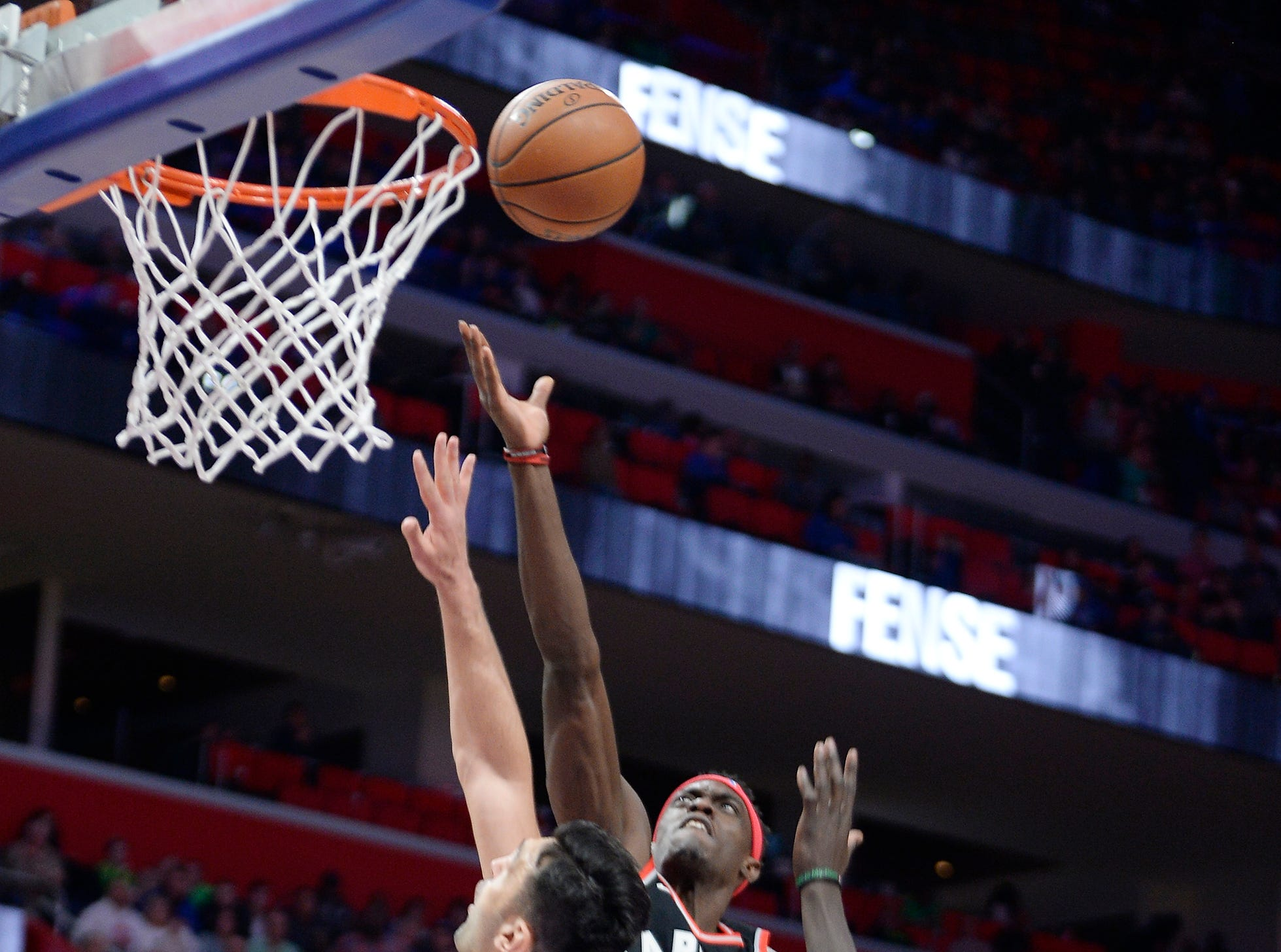 Raptors' Pascal Siakam scores over Pistons' Zaza Pachulia in the second quarter.