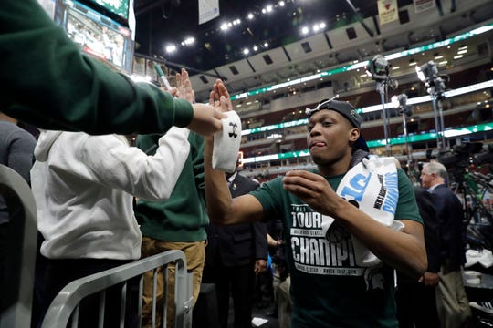 Michigan State's Cassius Winston celebrates after defeating Michigan in the Big Ten tournament on Sunday, but a short time later saw his team fall into the same bracket as the No. 1 overall seed Duke.