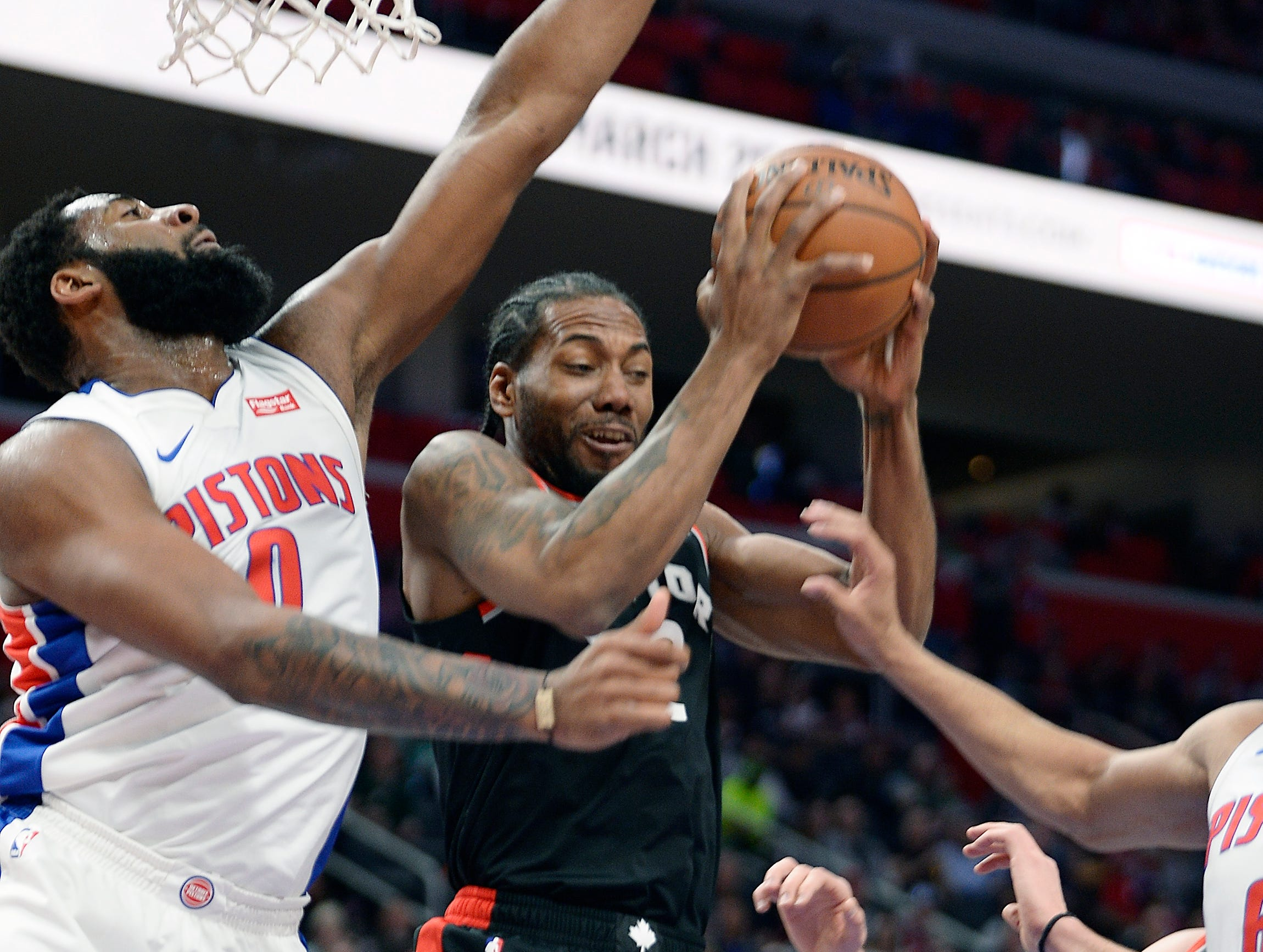 Pistons' Andre Drummond defends the Raptors' Kawhi Leonard in the first quarter.