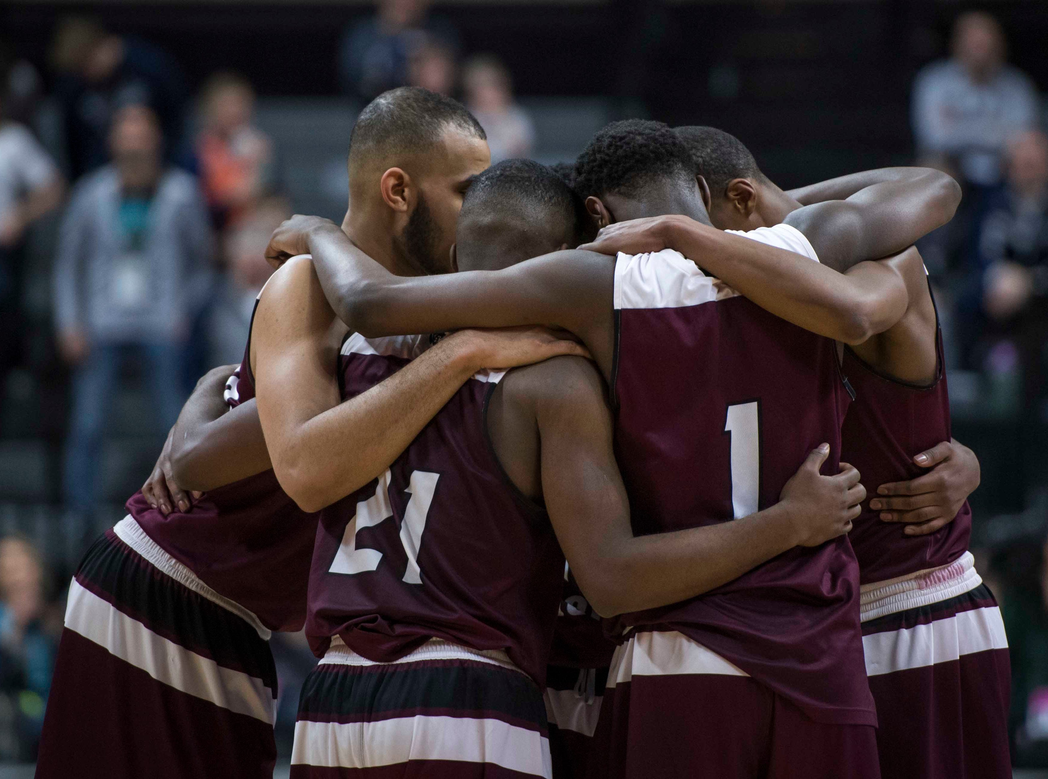 River Rouge players huddle together in the second half.
