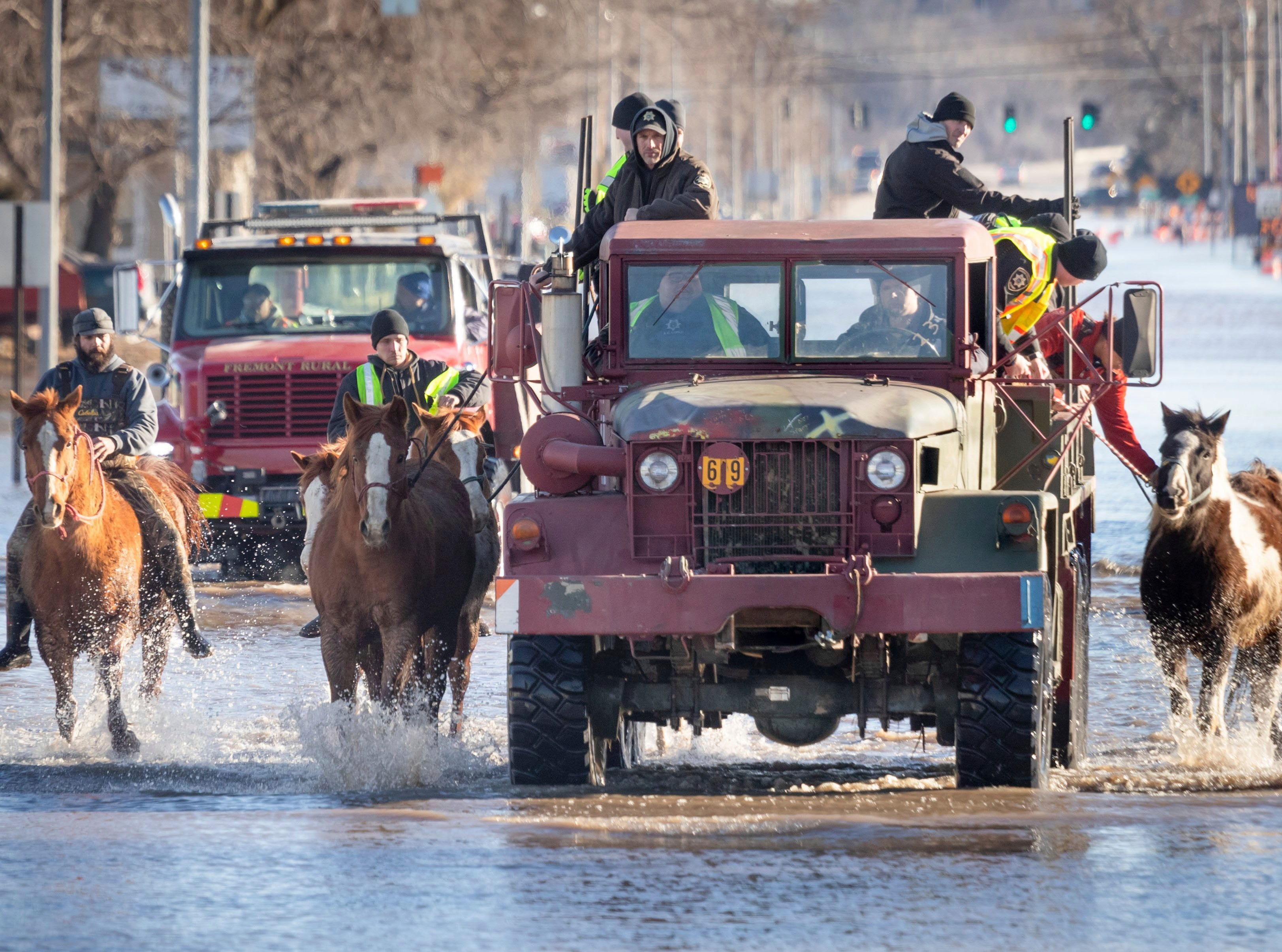 Horses that were being boarded in Inglewood, Neb., are moved through floodwaters to higher ground in Fremont Neb., Friday, March 15, 2019. The flooding followed days of snow and rain, record-setting in some places, that swept through the West and Midwest.