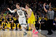 Michigan State's Matt McQuaid makes a 3-pointer during the first half.