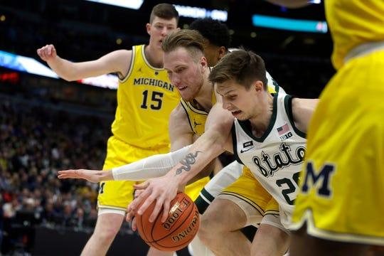 Michigan State's Matt McQuaid (20) scored a career-high 27 on Sunday against Michigan in the Big Ten tournament championship.