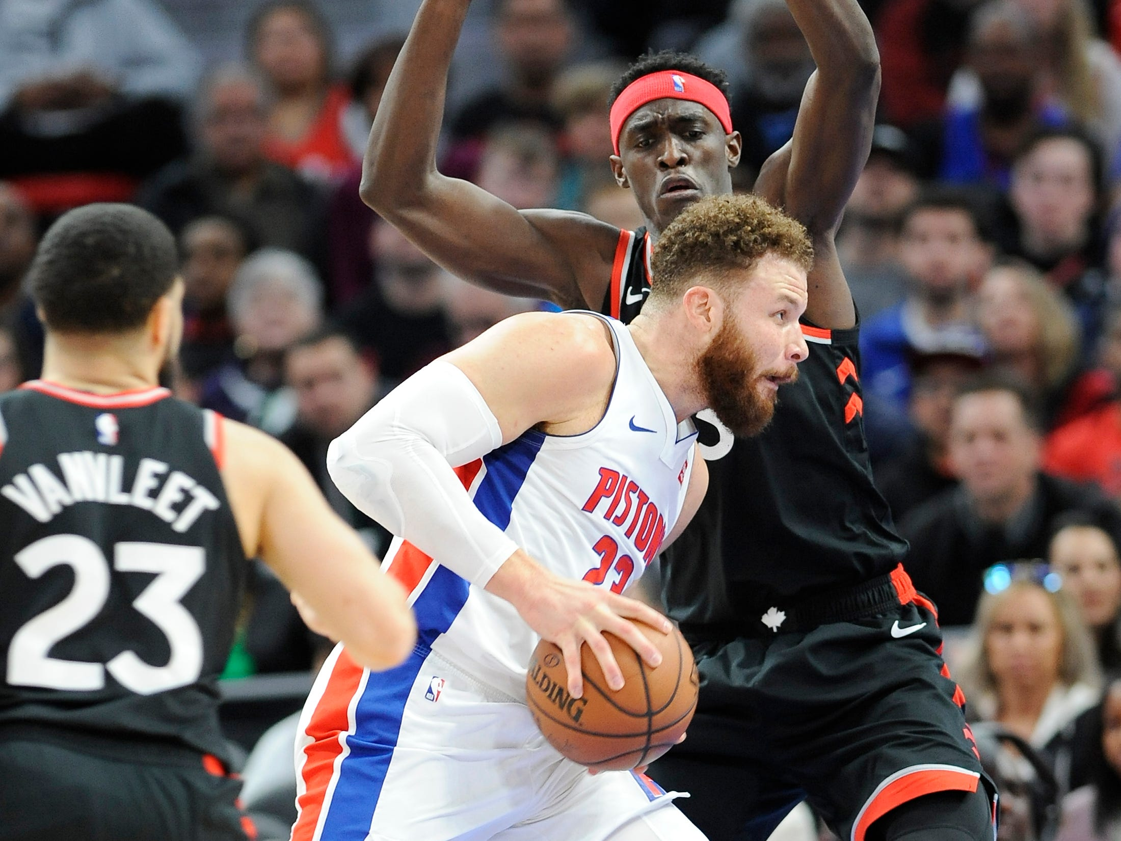 Pistons' Blake Griffin drives around Raptors' Pascal Siakam in the first quarter.