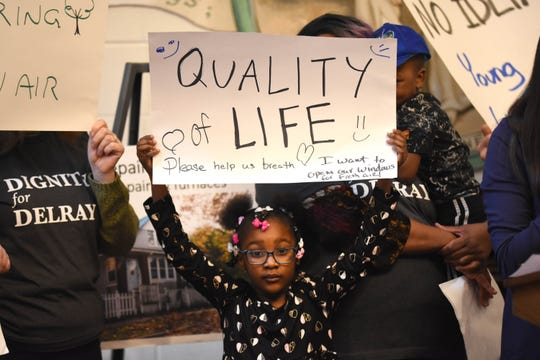 Khloe Johnson holds a sign.