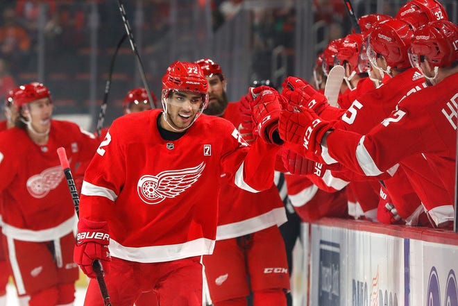 Detroit Red Wings center Andreas Athanasiou celebrates his goal against the New York Islanders in the first period Saturday.