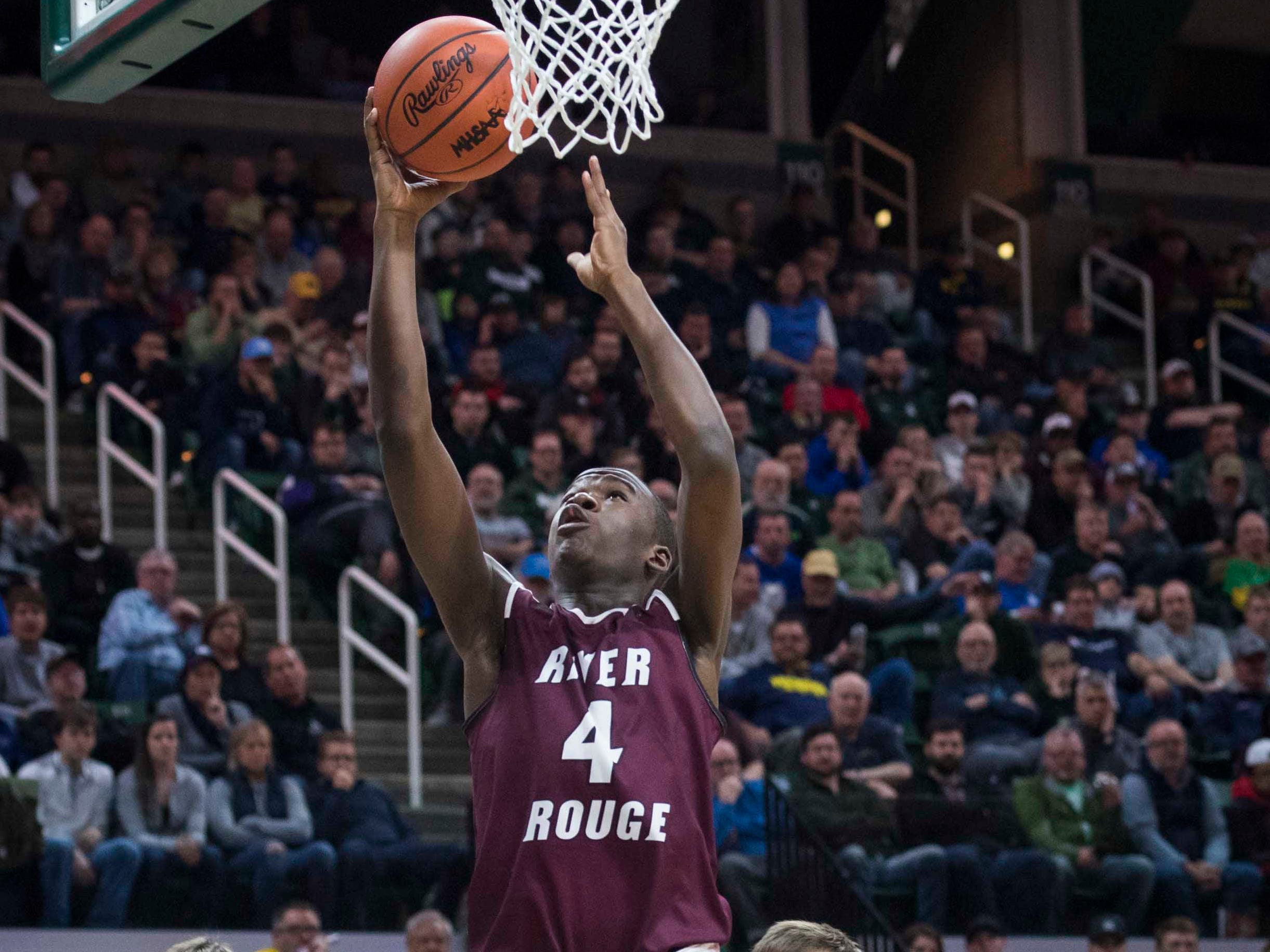 River Rouge's Legend Parrish shoots a layup in the first half.