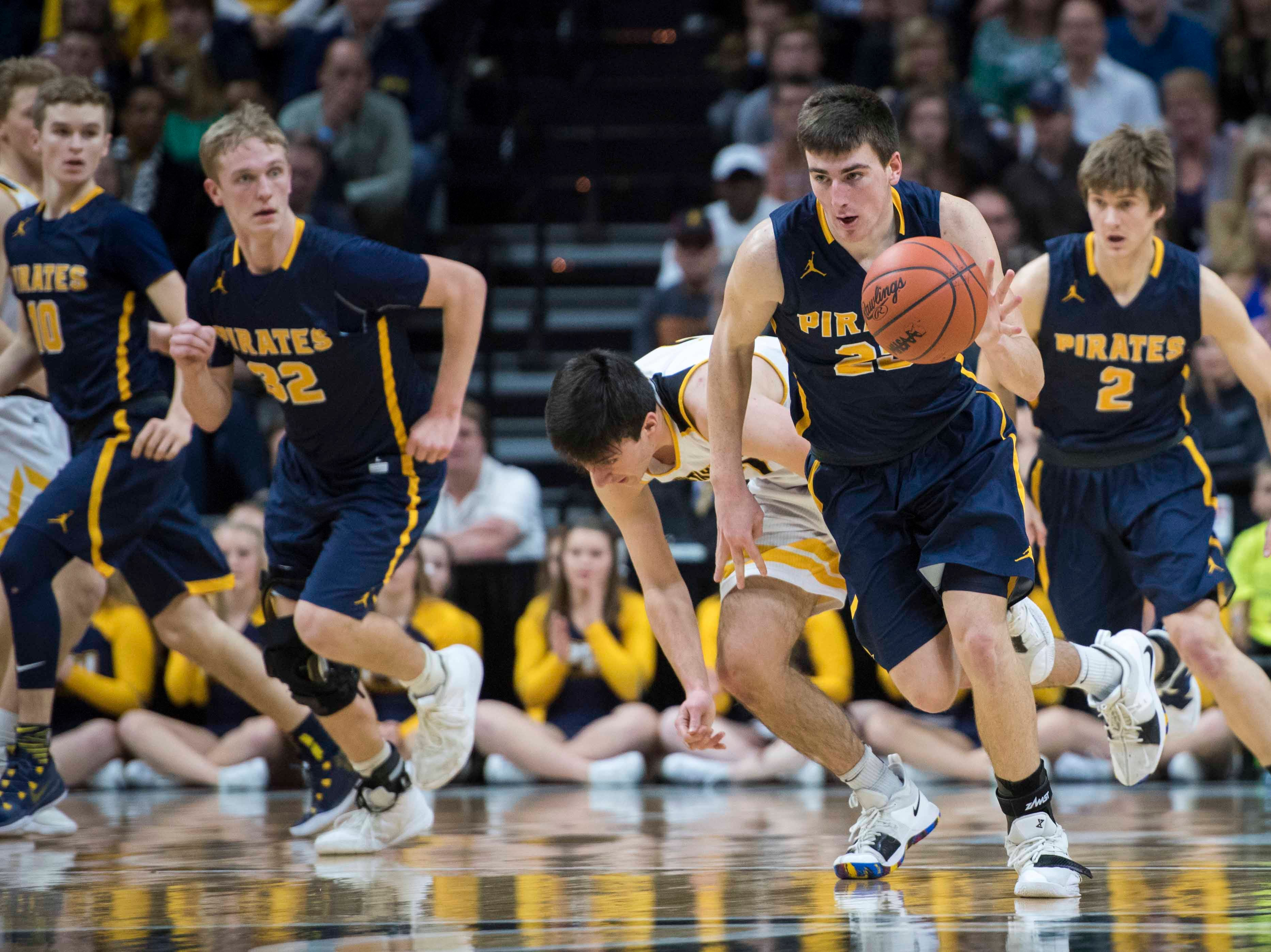 Pewamo-Westphalia's Aaron Bearss drives the ball up the court in the first half.