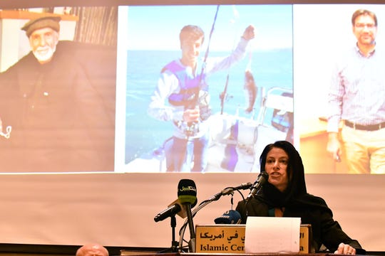 Michigan attorney general Dana Nessel speaks in front of a backdrop of the victims of the mosque shooting in New Zealand at the Standing Together Against Hate and Terror Community Memorial at the Islamic Center of America in Dearborn, Mich. on March. 17, 2019.