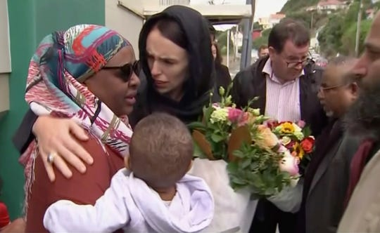 In this image made from video, New Zealand's Prime Minister Jacinda Ardern, center, hugs and consoles a woman as she visited Kilbirnie Mosque to lay flowers among tributes to Christchurch attack victims, in Wellington, Sunday, March 17, 2019.