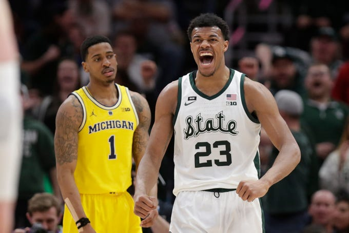 Michigan State's Xavier Tillman (23) reacts during the second half of an NCAA college basketball championship game against Michigan in the Big Ten Conference tournament, Sunday, March 17, 2019, in Chicago. Michigan State defeated Michigan 65-60 to win the tournament.